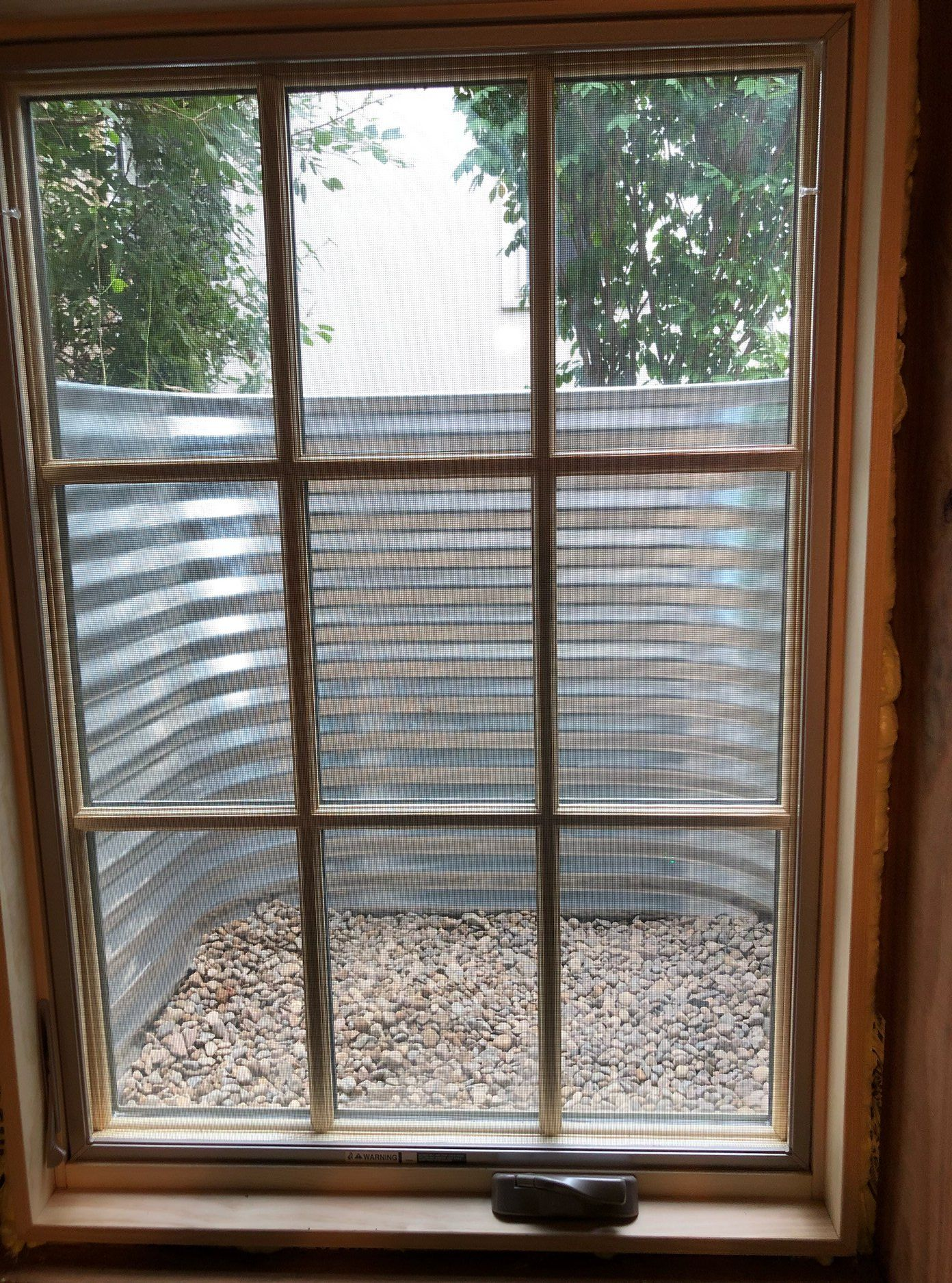Great Looking Custom Marvin Integrity Casement Window In A Galvanized Well Installed For Custome Basement Windows Casement Windows Replacement Casement Windows