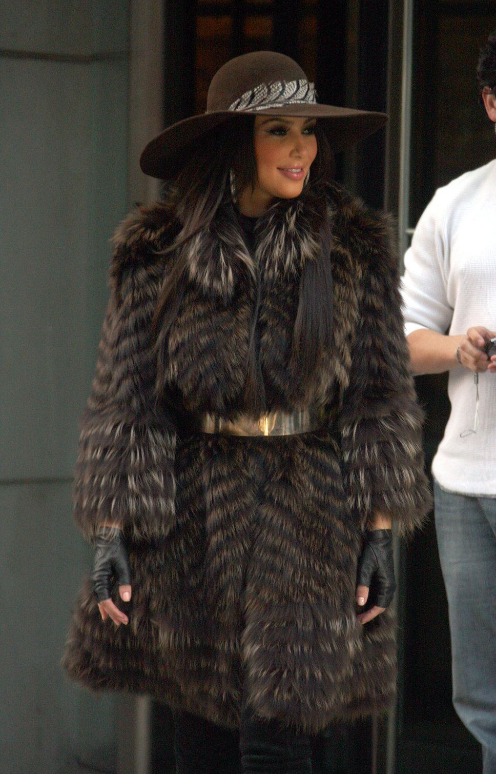 Kim Kardashian fur coat floppy hat gold belt brown hair - Photo ...