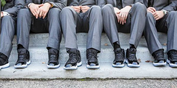 Groom and Bride loves their MJ shoes so why not have the bridal party wear  their fav Micheal Jordan shoes as well. Clever.