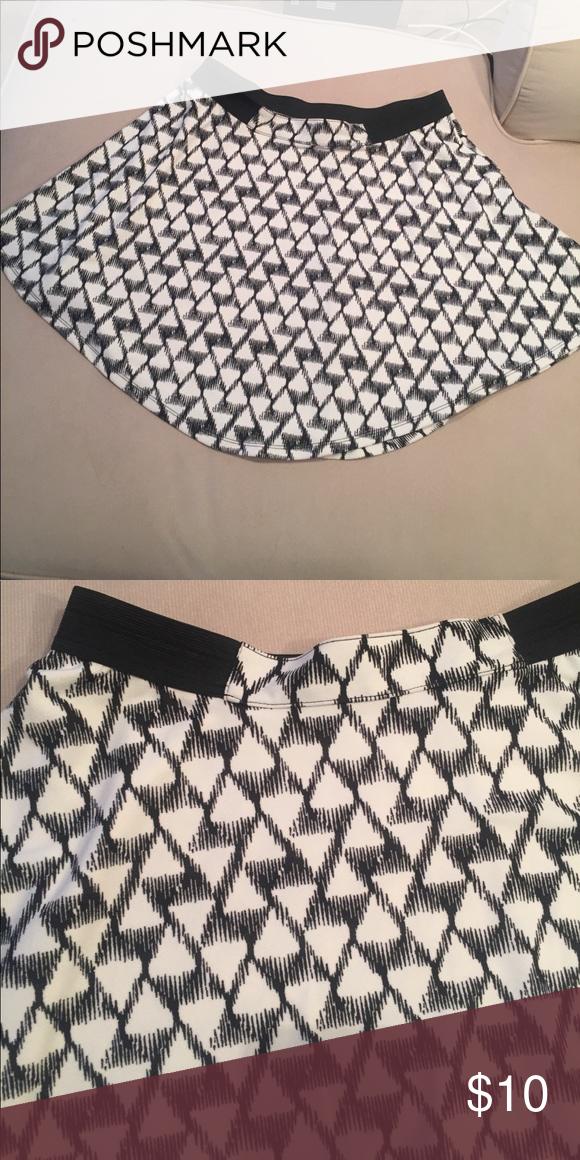 Geometric print skater skirt Black and white skater skirt with geometric print. Perfect condition. Great skirt. 95% polyester 5% spandex. Elastic waist. Skirts Mini