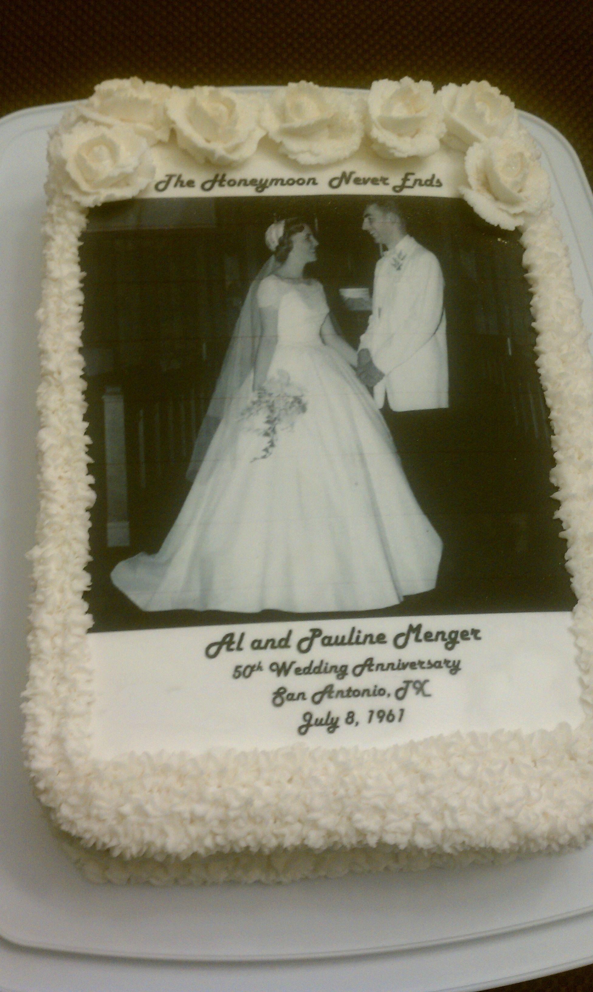 50th wedding decorations ideas  Anniversary Cake w Mom and Dadus wedding photo on it  Yummy
