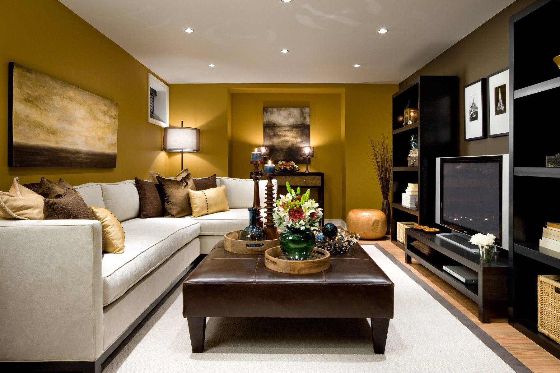 A Small And Cozy Living Room With A Slipcovered Sofa In Cream And