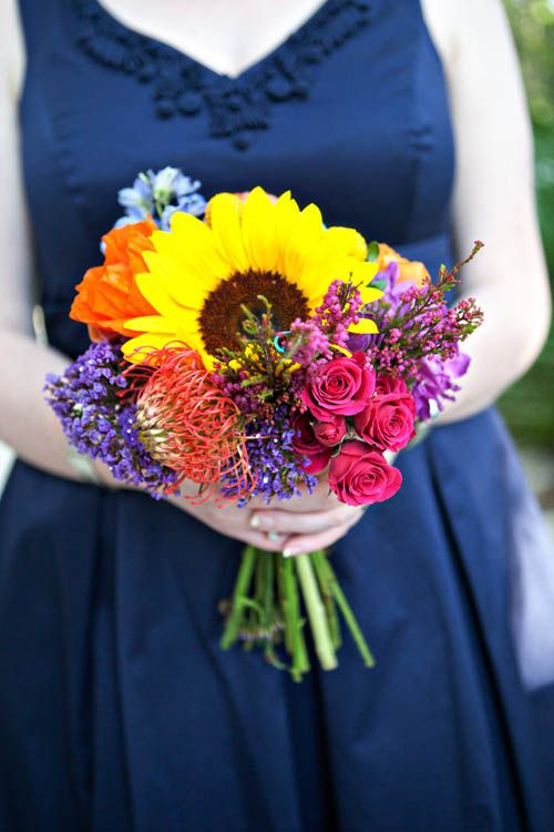 Fun mixture of wedding flowers. As you plan for wedding flowers, keep in mind that you don't have to follow a pattern. Make the bouquets and arrangements distinctly YOU!
