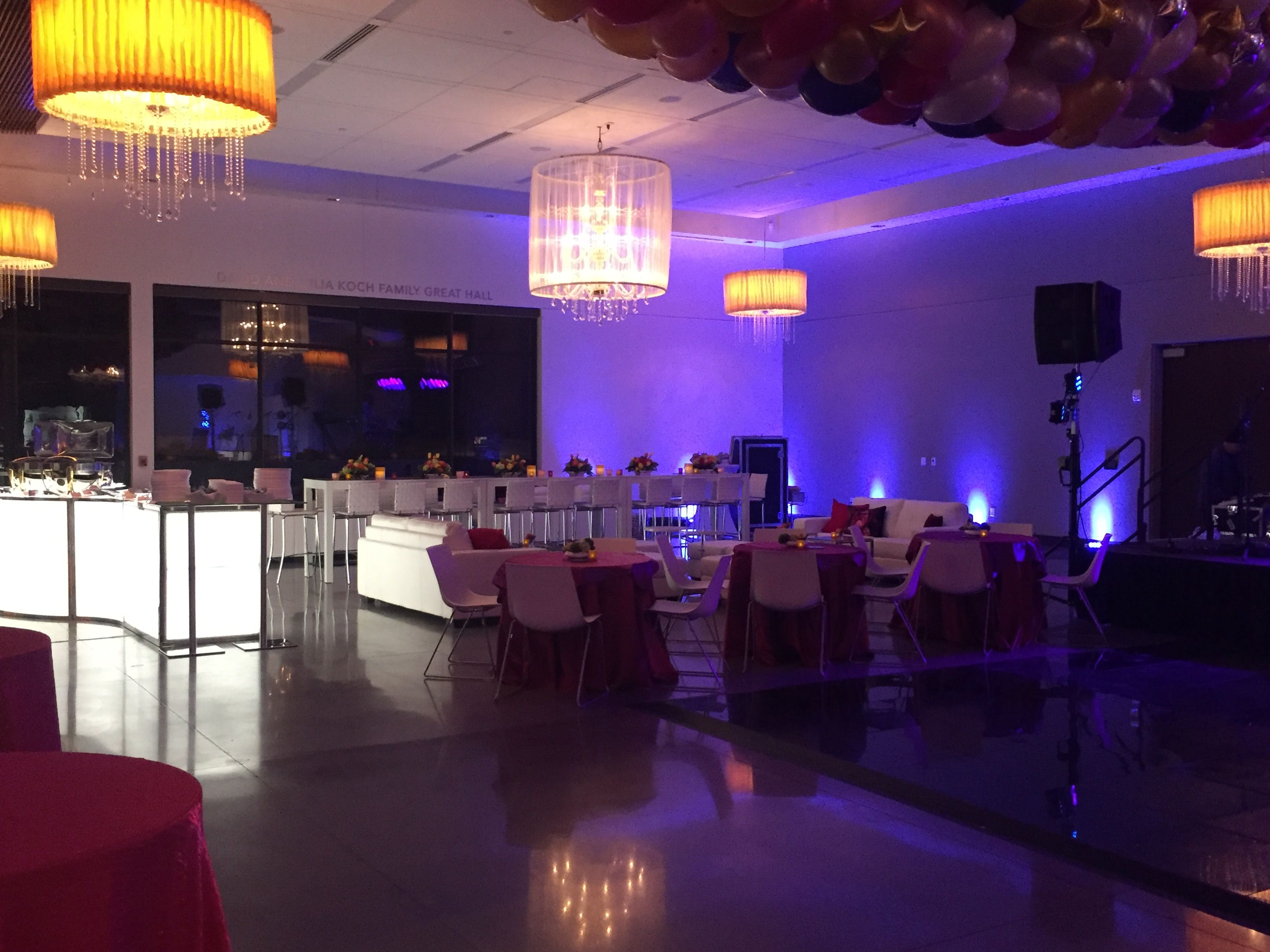 Light fixtures add elegant touch to lounge area at wedding wedding color lighting partyplanning weddingplanning purple wedding seating lounge
