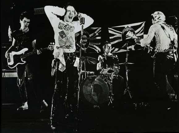 Sex Pistols    By Sex_Pistols_GSTQ_Promo.jpg: Warner Bros. (corporate author); unknown photographer derivative work: Benzband (Sex_Pistols_GSTQ_Promo.jpg) [Public domain], via Wikimedia Commons