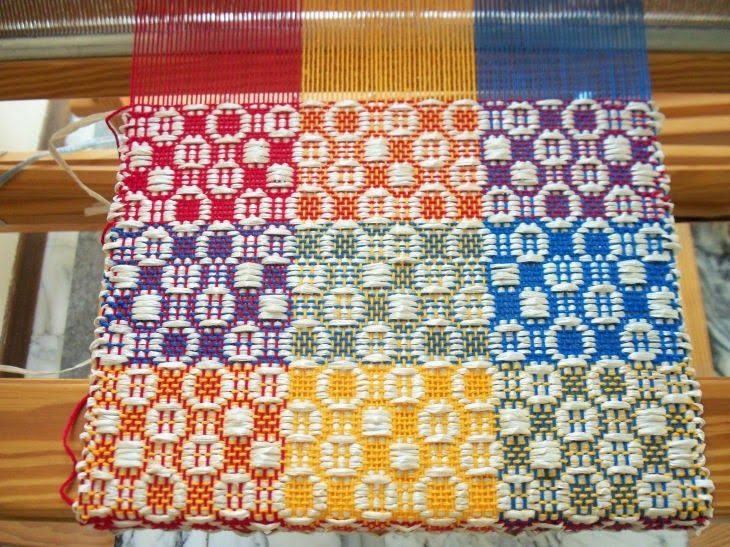 Weaving with red, yellow and blue gives the illusion of orange (red and yellow), green (blue and yellow) and purple (red and blue). How cool is that?