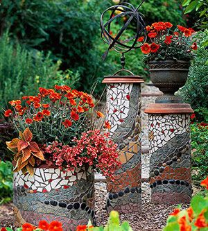 Create Mosaic Magic in Your Garden:  Eight, 10- and 18-inch-diameter PVC pipes cut to varying heights serve as the bases for these mosaic pillars. Overturned terra-cotta saucers turn two of the pipes into pedestals; the third cradles a flowerpot.