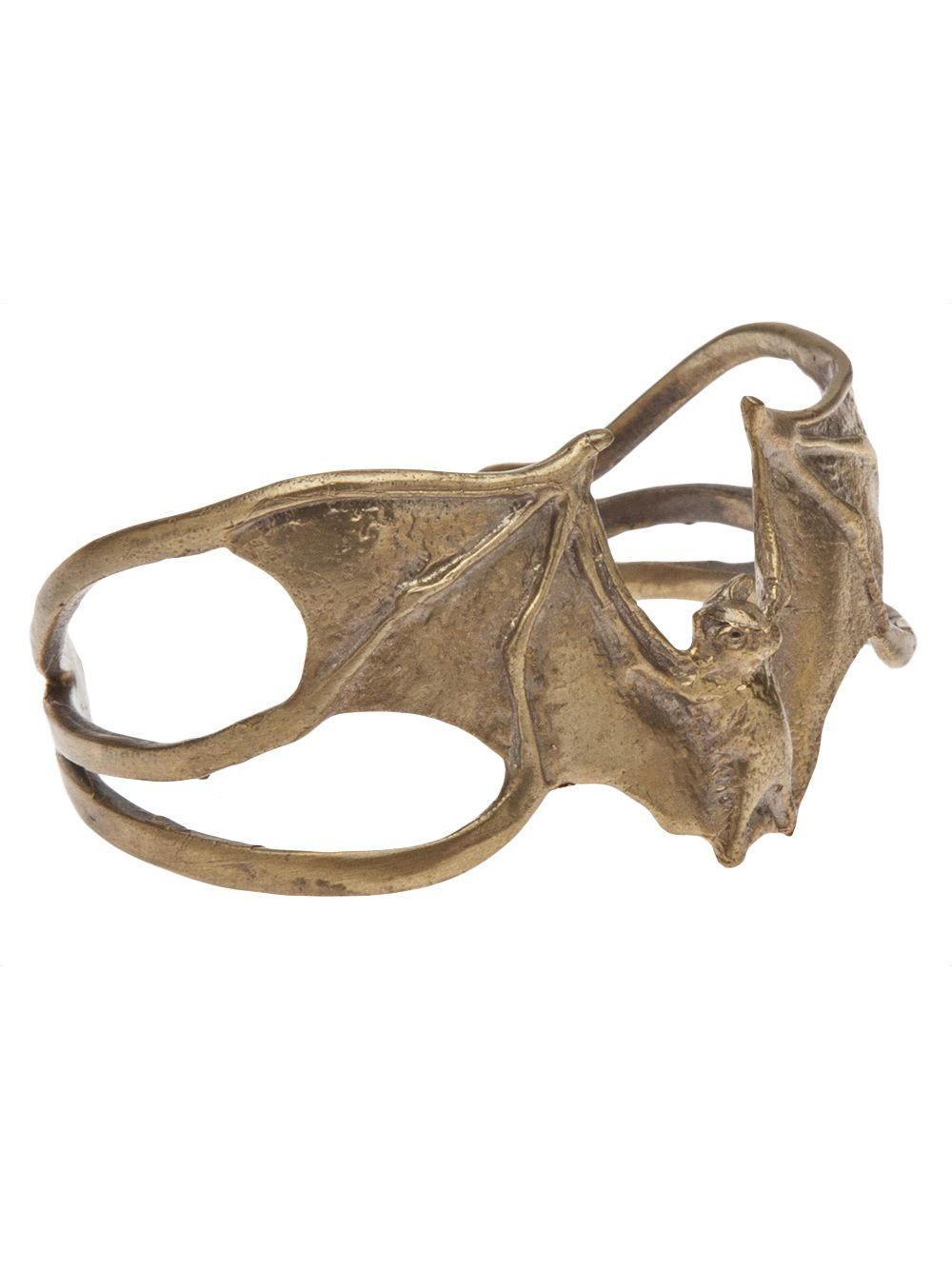 "Bat cuff in bronze from Alkemie Jewlery. This mixed metal cuff features a bat center with engraved detail, asymmetric side cutaway detail, and curved edges. Measures: 2.5""W x 2""L."