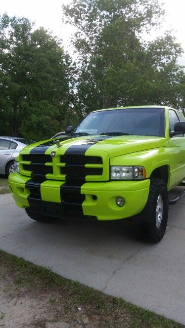My Big Lime Green Machine 2000 Dodge Ram 1500 V8 5 9l Has All Terrain Tires Body Lift And Under Glo American Pickup Trucks Lowered Trucks All Terrain Tyres