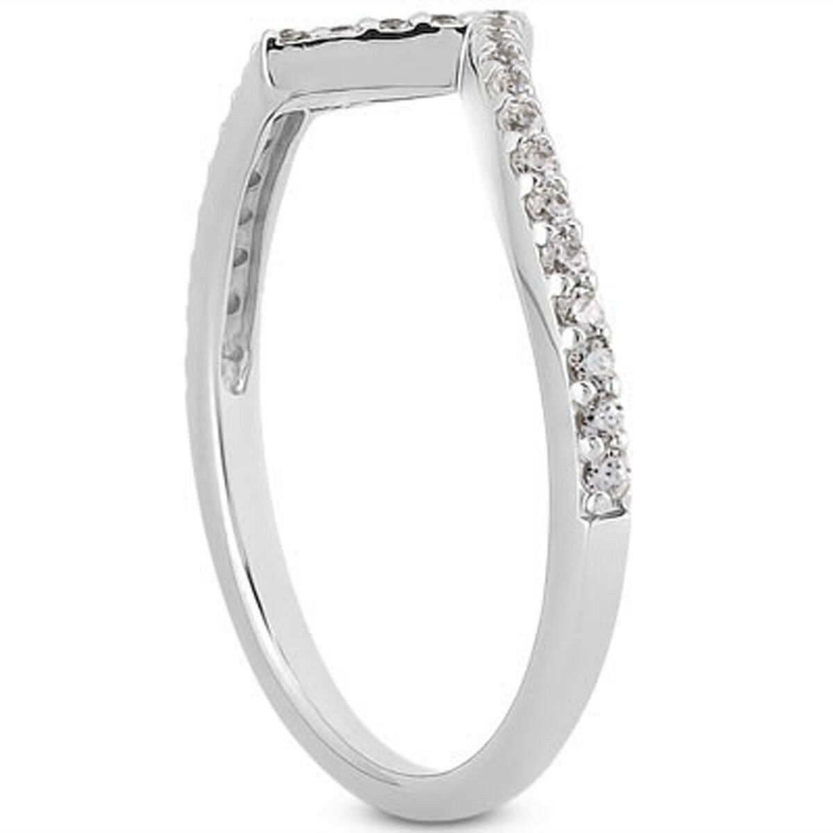 The exciting design of this modern ring brings an artistic appeal to its unique appearance suggesting motion and brilliance this ring is emblematic of the moment when love hits you like a bolt of lightning. Glittering diamonds decorate the ring half way around. Size 7.5 Rhodium Polish: No Line Item Type: Diamond Metal Name: White Gold Metal Content: 14K Style Name: Diamond Accent Width: 1.6 mm Average Color: I (Diamond) Average Clarity: SI2 (Diamond) Min ct. tw.: 0.26 (Diamond) Shape: Round (Dia