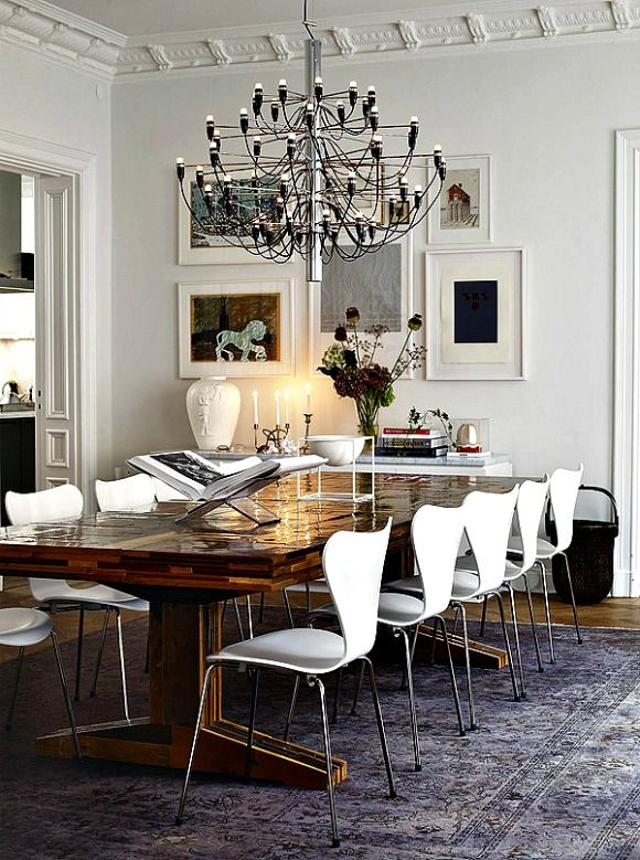 Series 7 Chairs And Model 2097 30 Chandelier Are Cool Funky Choices In This Dining Room