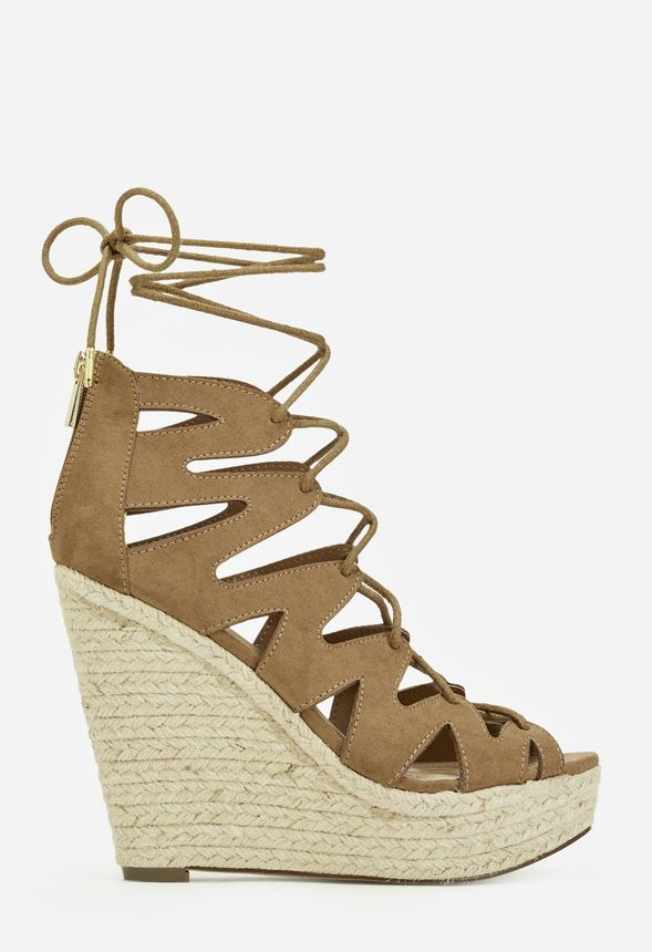 ffb316b55c9f2 This lace up wedge is not one to miss! Emilia will be your new go-to, with  cutout details and a braided wedge. You can't say no.