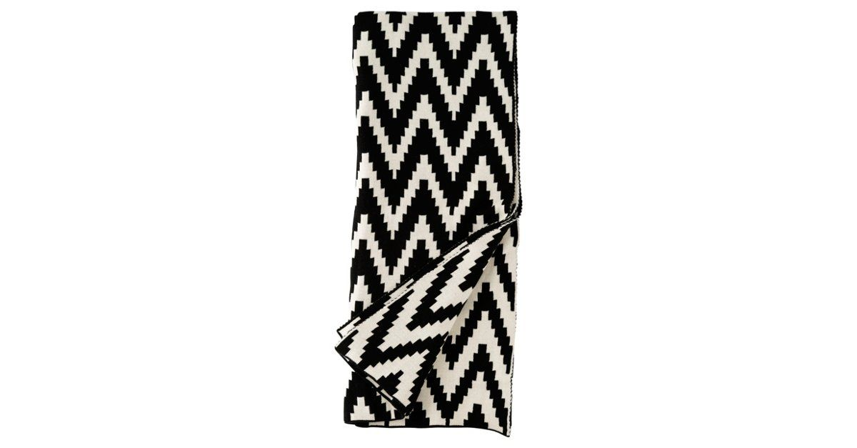 For an instant injection of energy, you can always count on chevrons. And when those chevrons are rendered in bold black and white, as on this cotton throw, the effect is marvelously mod as well.By...