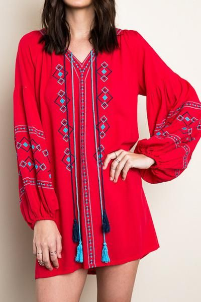 Beautiful diamond pattern embroidery and tassels make this dress anything but ordinary. The bright red adds a perfect pop of color to cold winter days. Another great winter-to-spring piece, wear with tights, boots and a jean jacket now, cute wedges or espadrilles come summer.