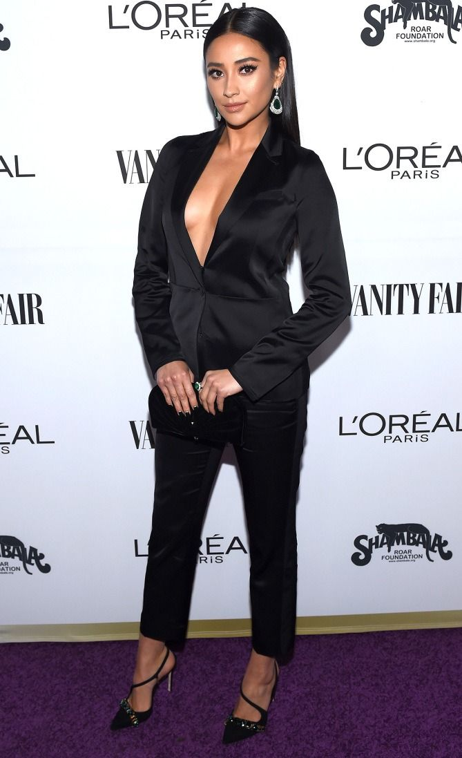 cbf6a8072d ... Dressed on the Red Carpet. Shay Mitchell in a plunging black suit