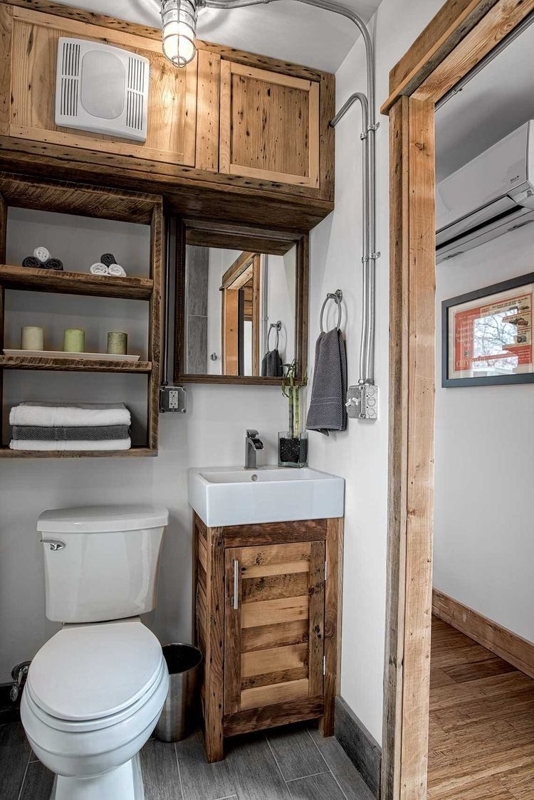 The Freedom Tiny House From Minimalist Homes Llc A 300 Sq Ft Shipping Container Home With A Sle Tiny House Bathroom House Bathroom Designs Tiny House Kitchen