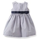 The bright stripes really pop to make this dress special.  A pre-tied bow and tulle underlay make it a sweet dress up look.