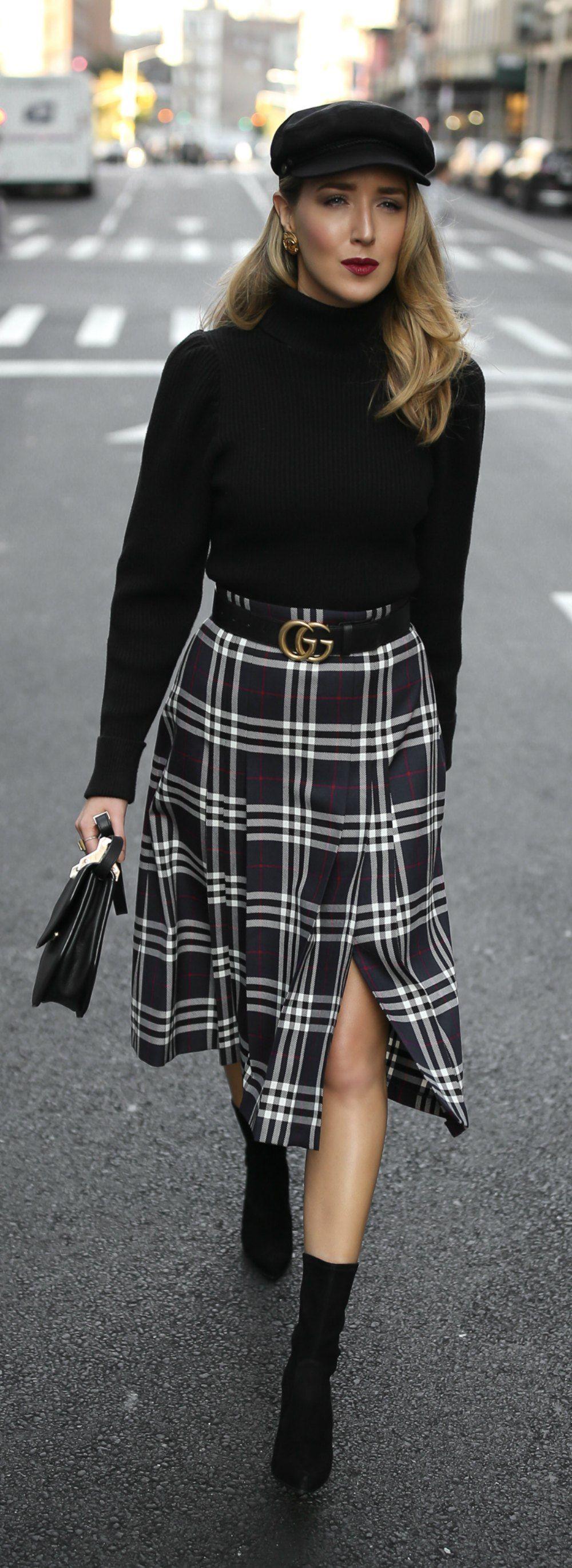 Pleated plaid midi skirt black puffedshoulder turtleneck black