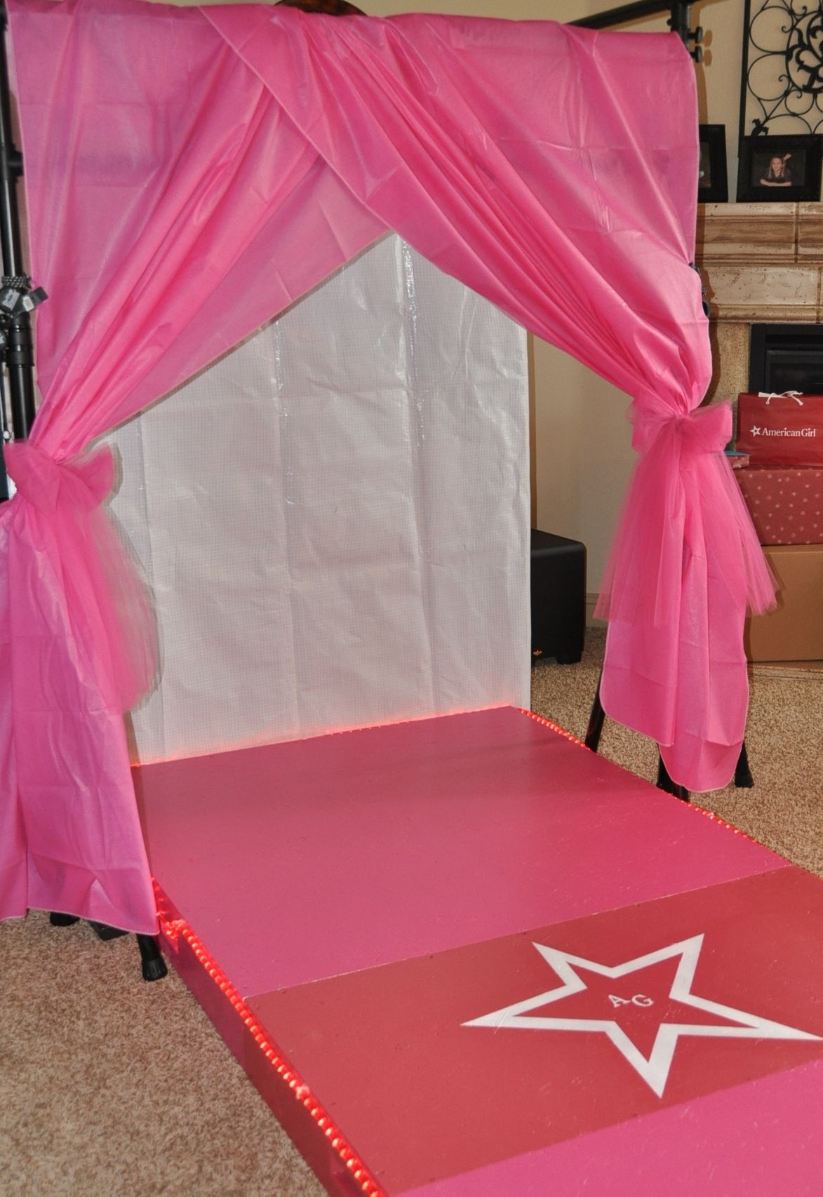Fashion Show Stage that daddy built...complete with pink rope lights ...