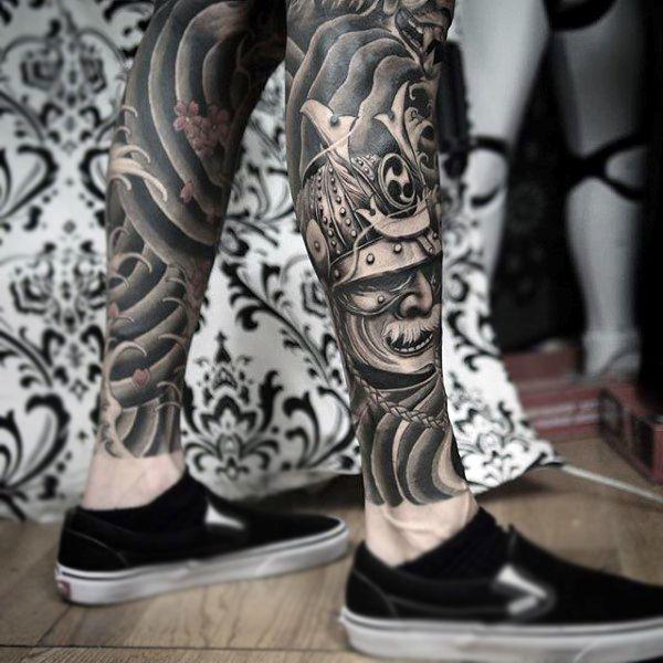 Black And Grey Samurai Warrior Tattoo On Man Right Leg Samurai Mask Tattoo Samurai Tattoo Design Mask Tattoo