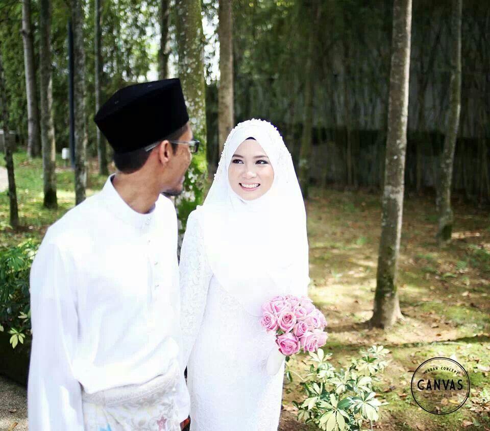 A beautiful happy bride a malay muslim newlyweds couple by canvas