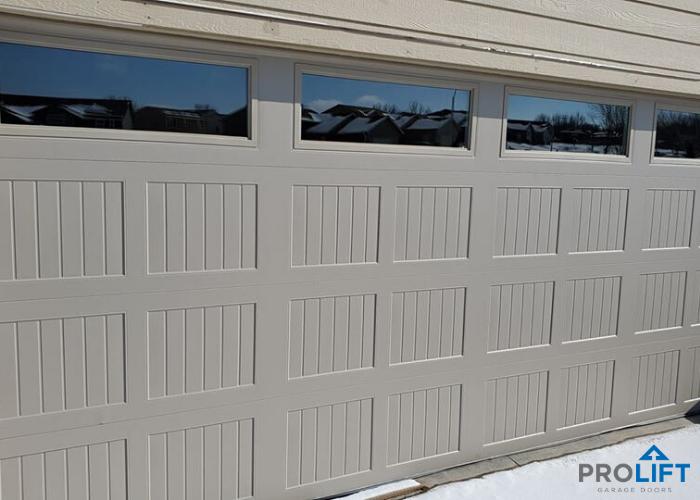Gray Steel Garage Door With Long Windows In 2020 Garage Doors Steel Garage Doors Doors