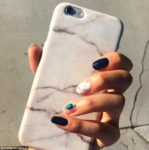 Zakuyi  kept things simple by adding a green stone to just one fingernail, alongside a white and grey polish that looked just like her marbled phone case