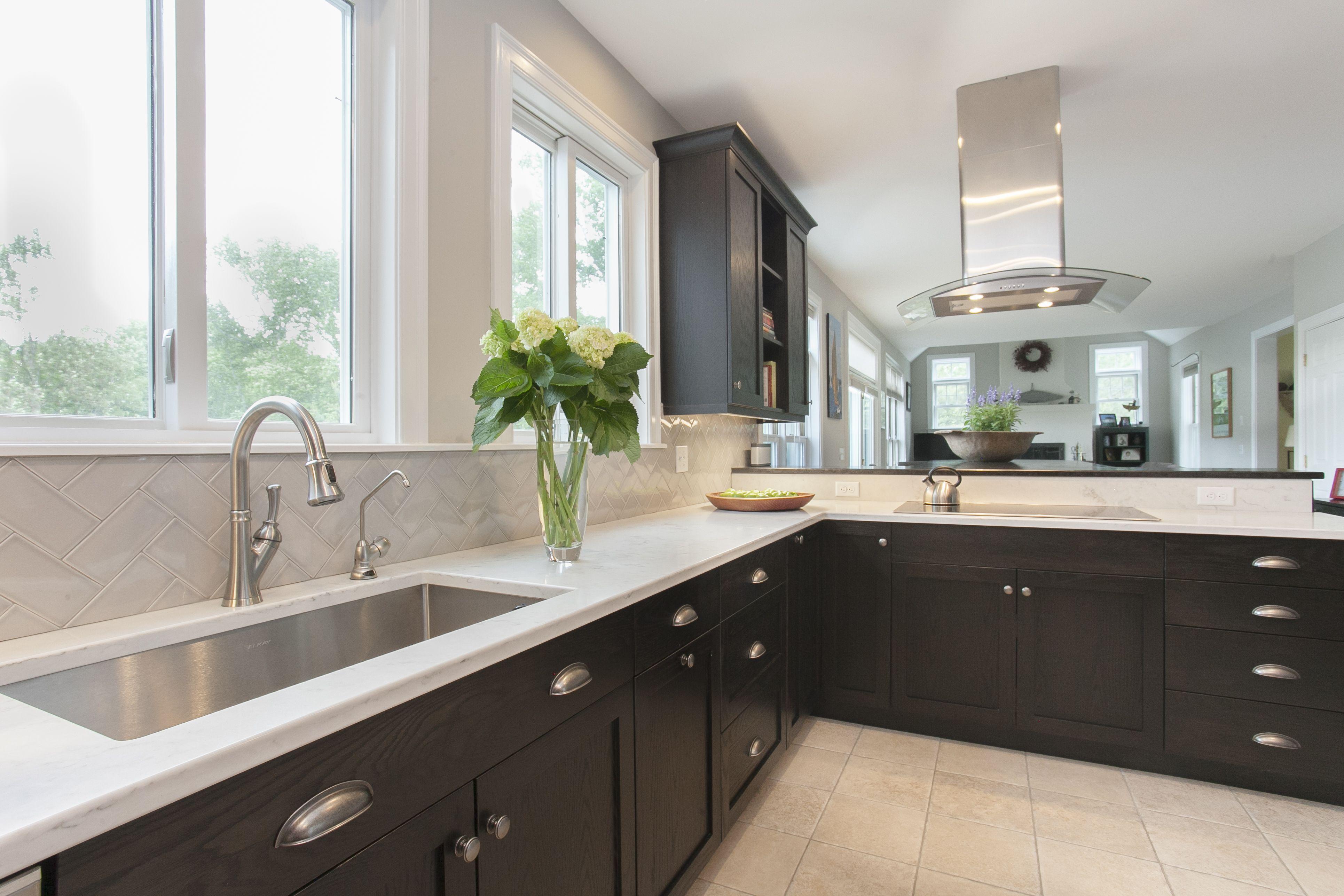 Sleek black cabinetry #blackcabinets #rangehood # ...