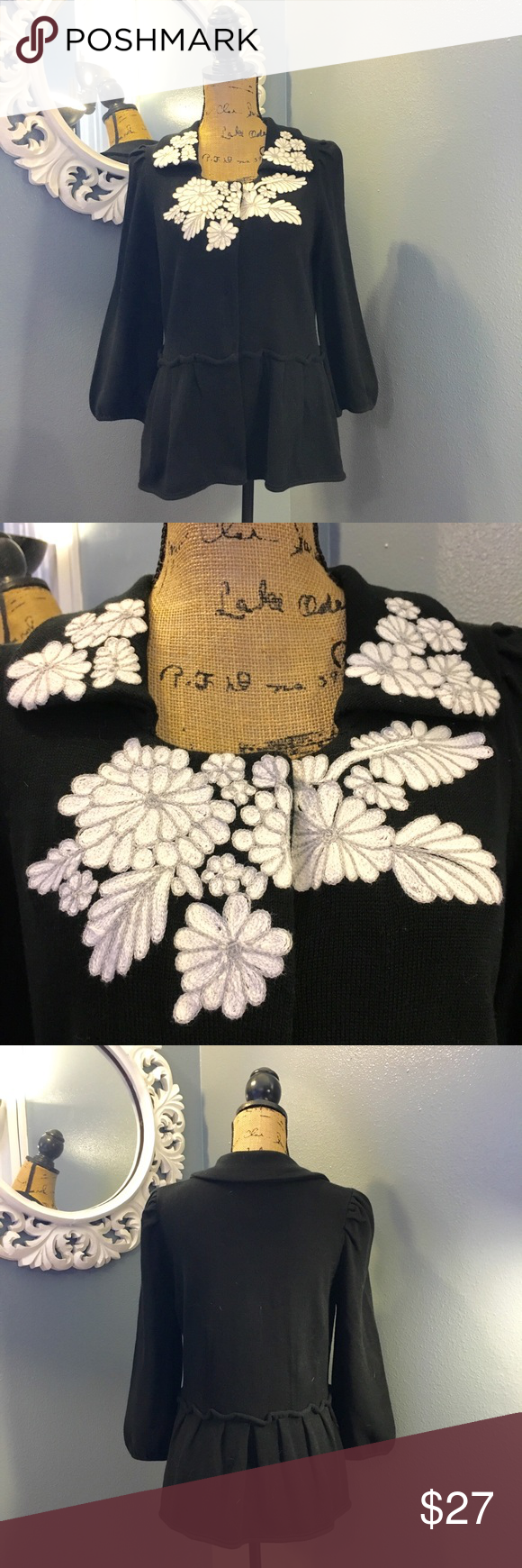 Black sweater with embroidered neckline Madison Black long sleeve heavier sweater. Large snap closure. Beautiful machine embroidery at neckline and on collar. Slightly gathered waistline. Gently worn. Madison Sweaters