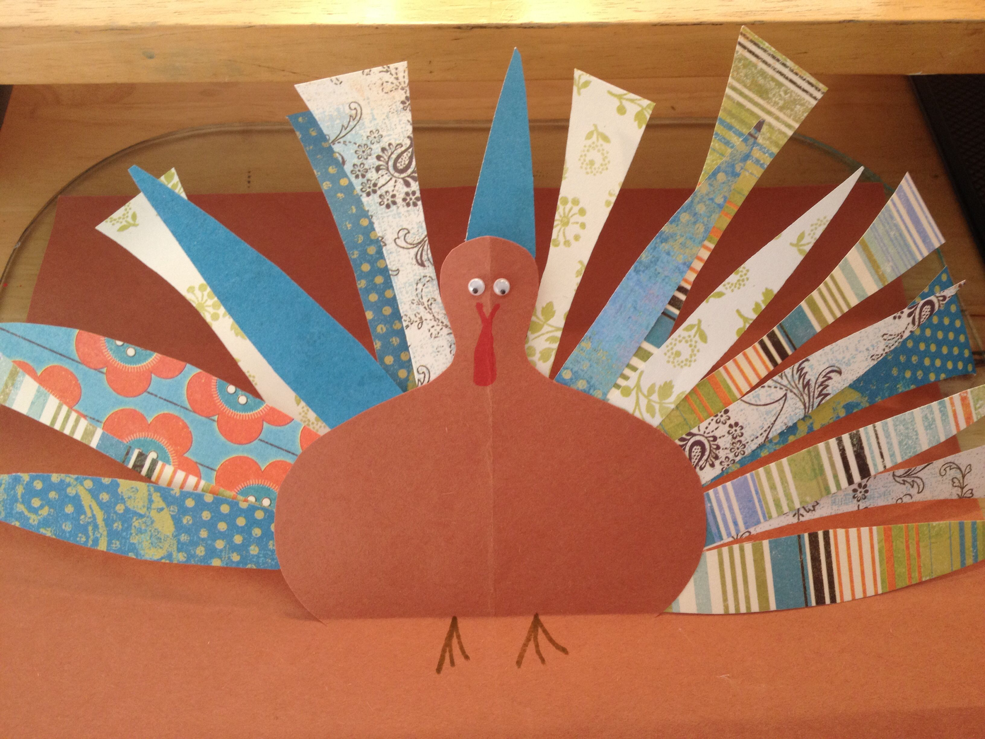 turkey made from cut scrapbook paper on construction paper | my art
