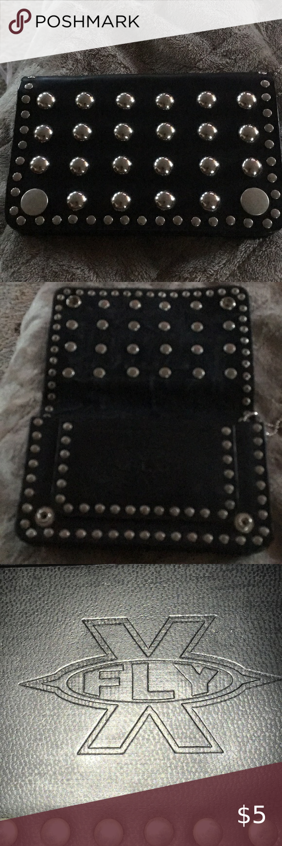 Leather Studded Wallet never used Black Leather studded Wallet never used. 2 snaps to close . X Fly Bags Wallets
