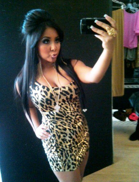 we all know who wears it best. the queen of leopard print :)