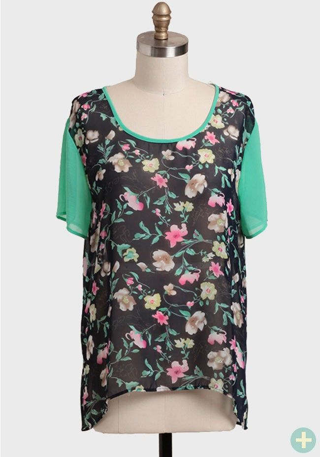 A colorful floral print adorns this navy and mint green chiffon blouse.