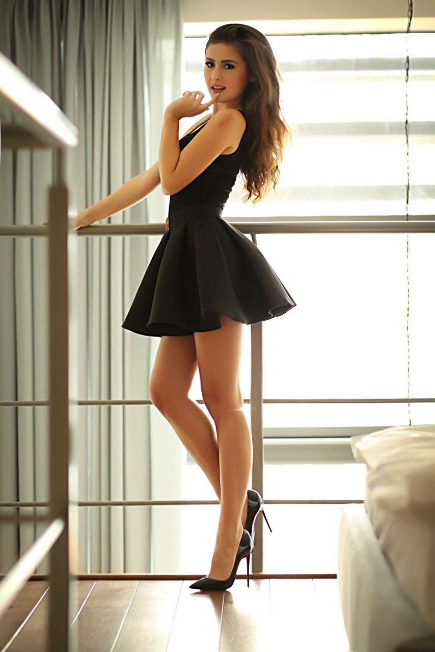 Black dress heels - Brunette Short Black Dress Naughty Pose With High Heels