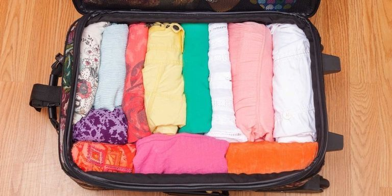 How to Fit Clothing in a Suitcase — How to Travel With Only a Carry On