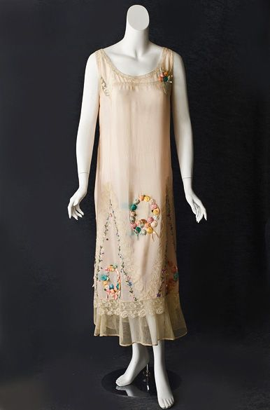 Fancy silk slip, c.1920. Trimmed with handmade filet lace and hand-embroidered flowers. Front