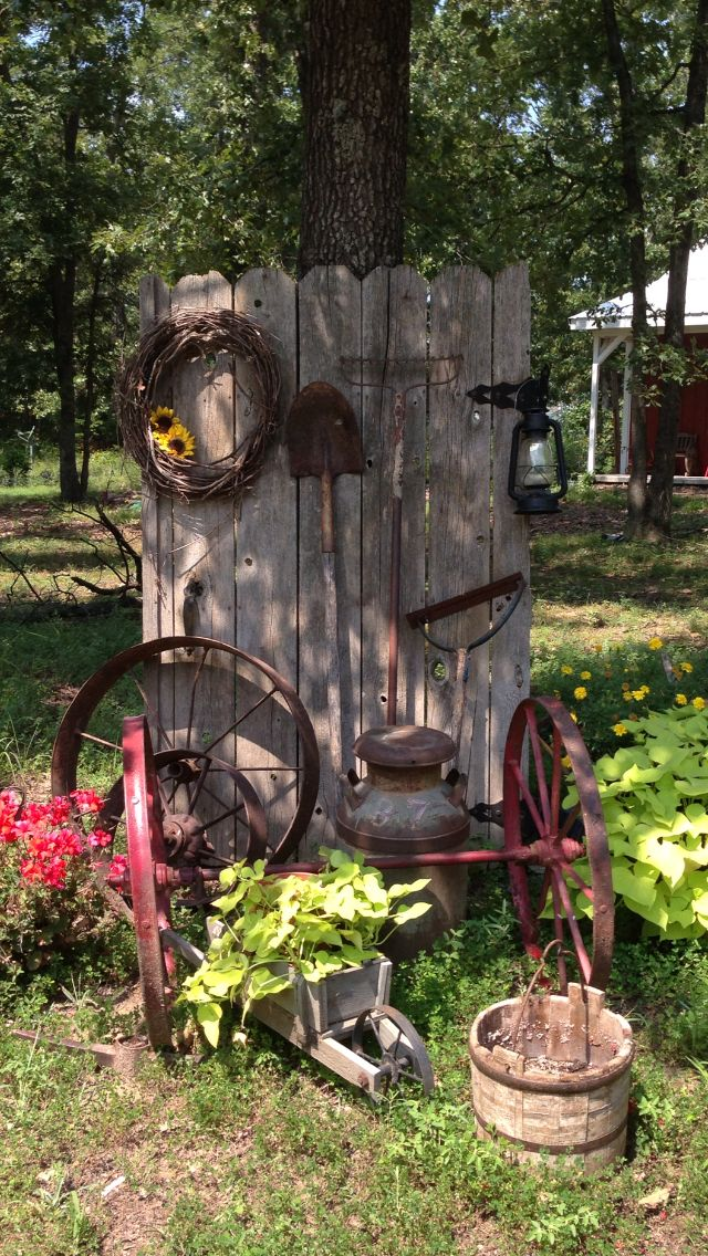 Old rusty tools, wheels by gate. #hoflandschaften