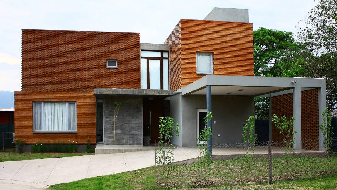 La casa tucumana que adora el ladrillo visto edificios for Casas modernas ladrillo