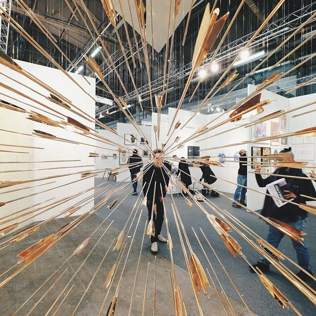 This past January, at the Honor Fraser Gallery in Los Angeles, artist Glenn Kaino showed A Shout Within a Storm, a mobile installation composed of more than 100 copper arrows pointing at an invisible target.