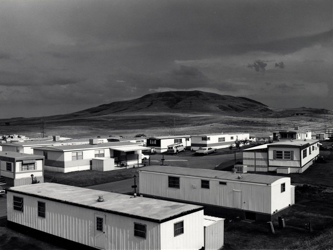 http://assets.dwell.com/sites/default/files/styles/large/public/2012/11/01/New-Topographics-Mobile-Homes-Jefferson-County-Colorado-by-Robert-Adams.jpg?itok=DOsjRG0v