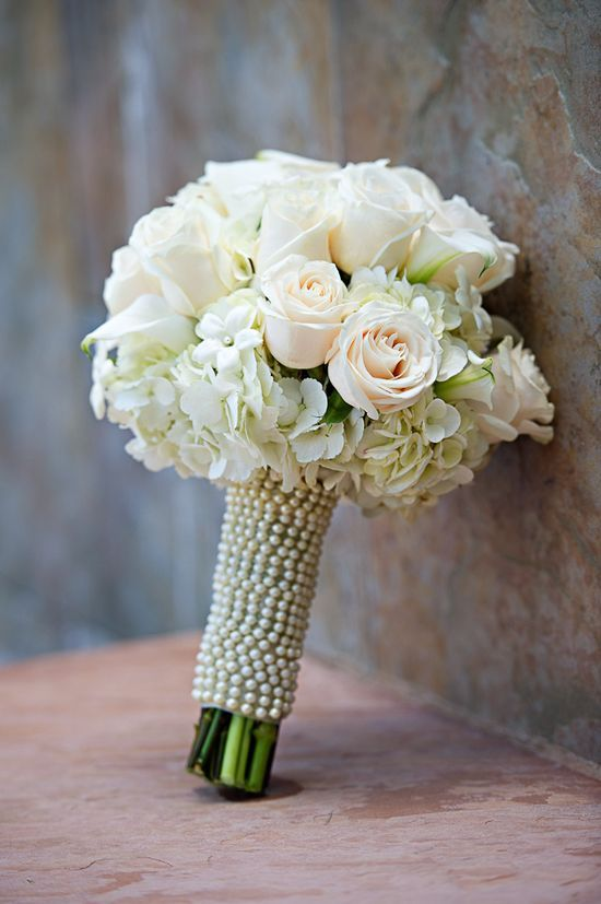 Flowers White Wedding Flowers---LOVE the pearls/beads around the bouquet.  For the 'tossing' bouquet, ask your florist to make a small version with shorter stems and white | http://flowerarrangement.lemoncoin.org