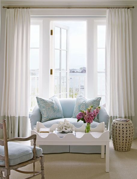 Review Framed by flowing drapes a blue settee and white coffee table make a pretty vignette Traditional Home Tria Giovan Design Lynn Morgan In 2018 - Simple Elegant sound curtains New