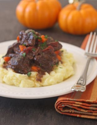 Braised Short Ribs with Creme Fraiche Mashed Potatoes (nicked from Bon Appetit). I'm doing the potatoes for the Thanksgiving menu.