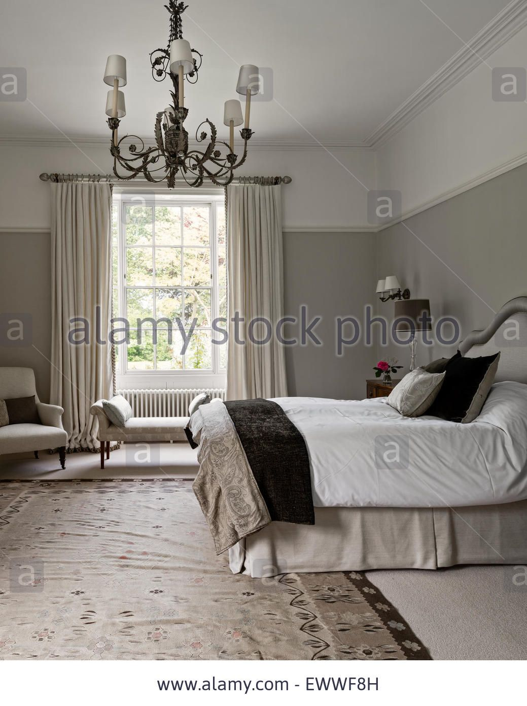 Elegant Bedroom Painted In Pale Walnut By Dulux With An Aubusson Rug. The  Curtains Are In Abbot And Boydu0027s Lins Brodes Stock Photo