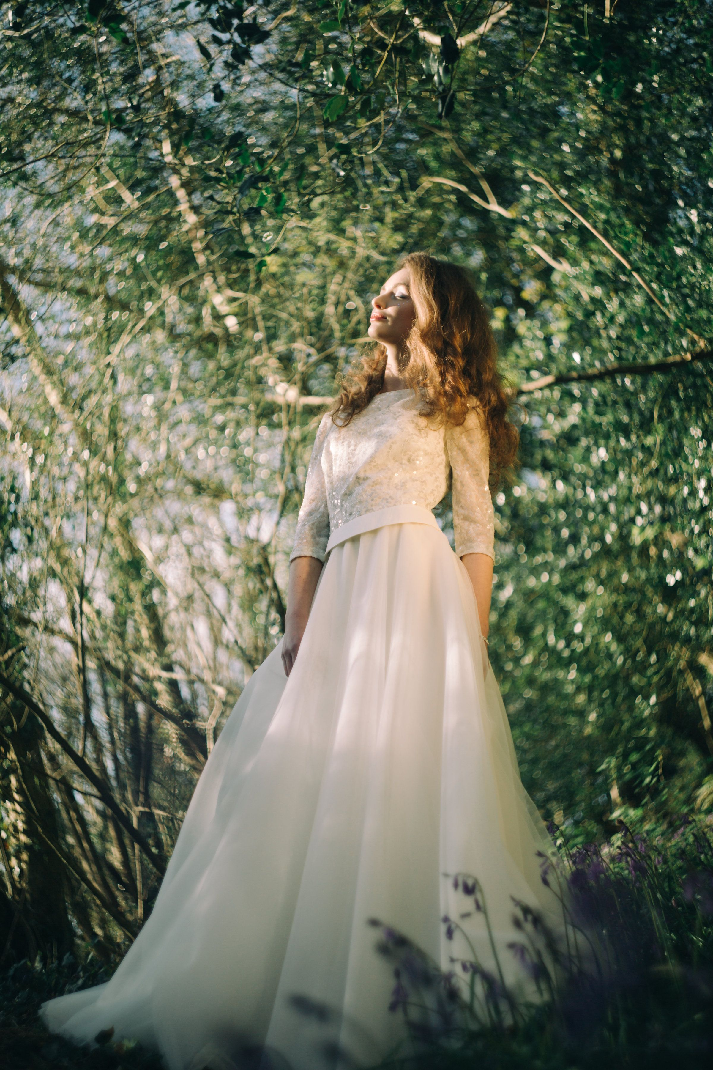 Wedding gown of cream sequin bodice with tulle full layered skirt, by Christine Trewinnard.