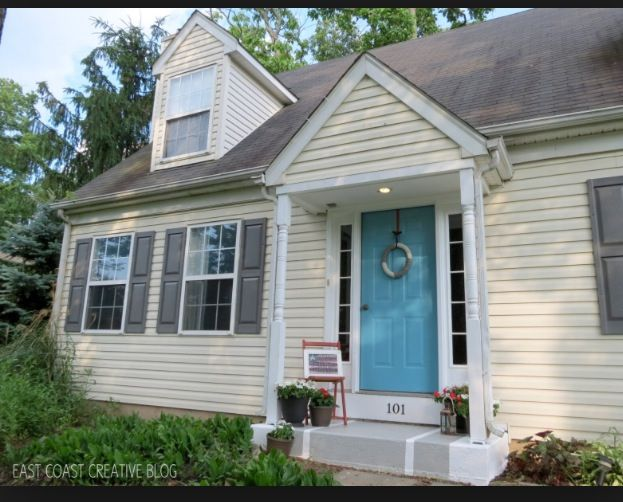 Yellow Siding Gray Shutters And Blue