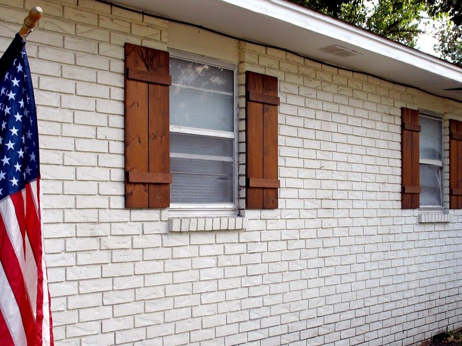 Wooden board-and-batten shutters, simple and straight-lined ...