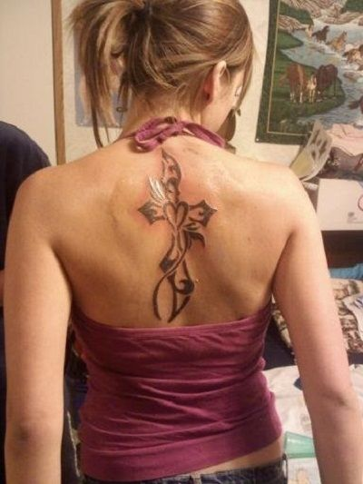A small heart and a big cross tattoo on back