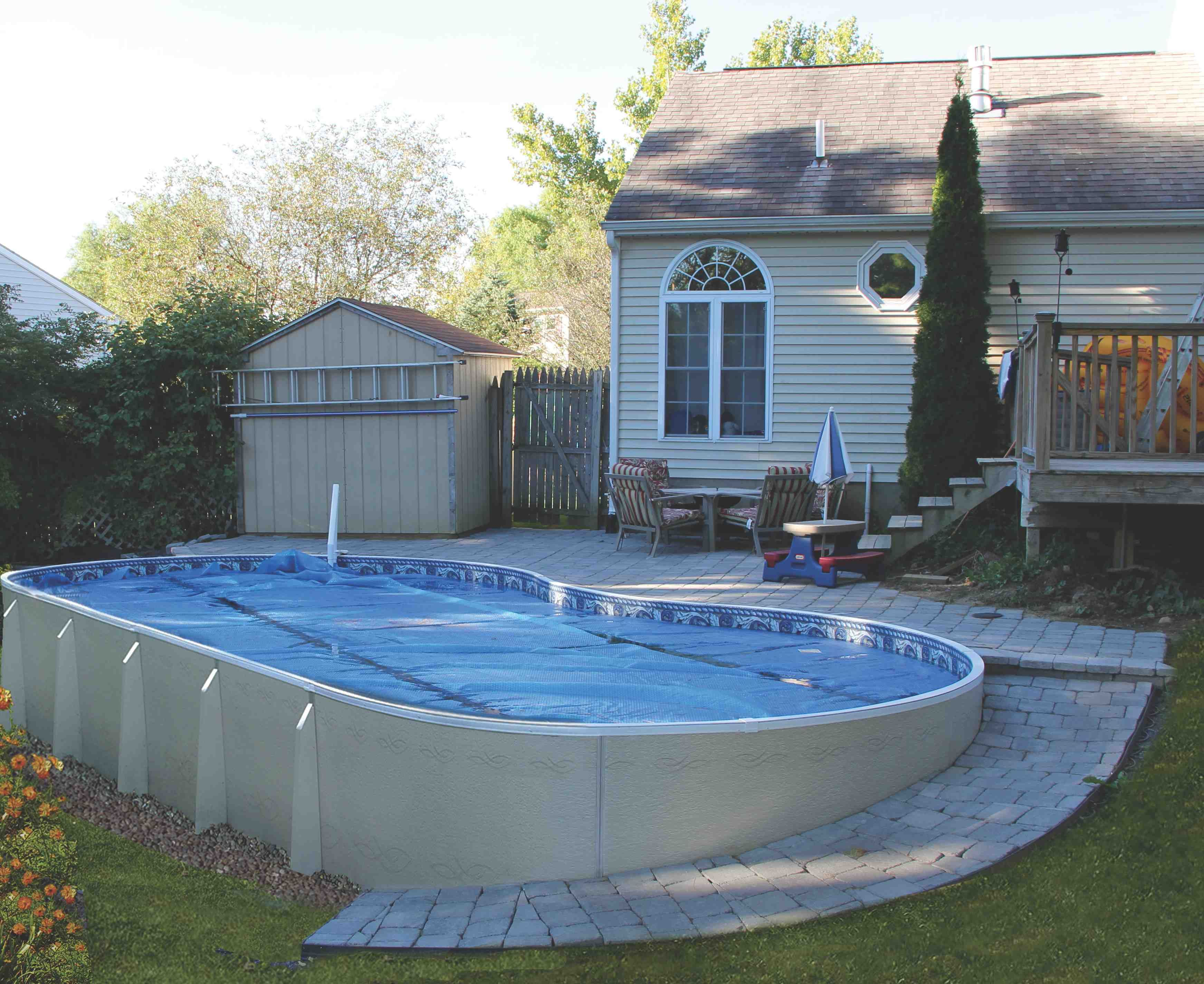 Contemporary outdoor design with enchanting semi inground for Images of inground swimming pools