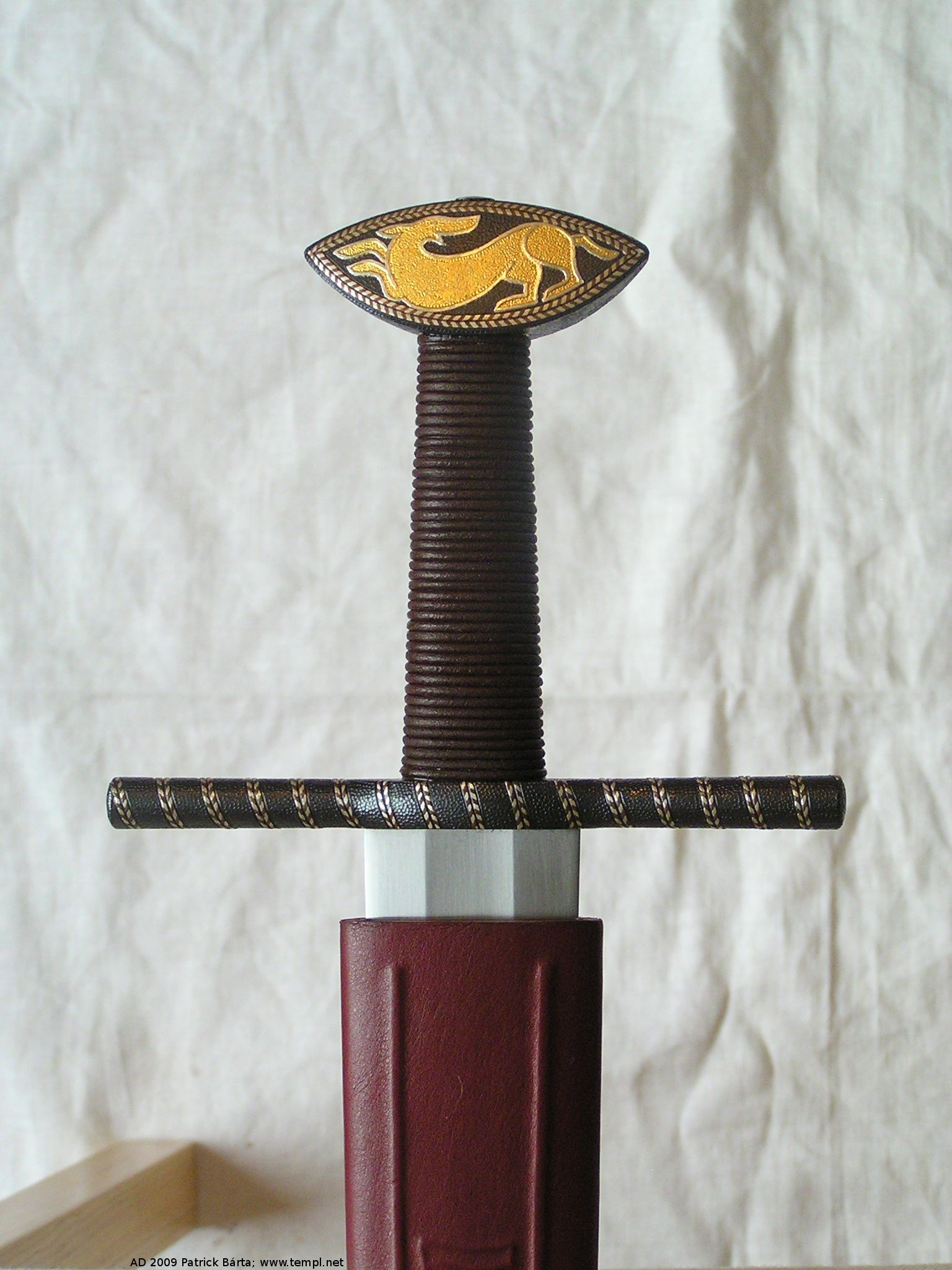 12th century museum replica by Patrick Bartl. Also a great website for early swords with lots on the making of early pattern welded blades.